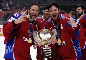 Russia's Morozov and Kovalchuk hold the trophy after beating Canada in the IIHF World Hockey Championship gold medal game in Bern